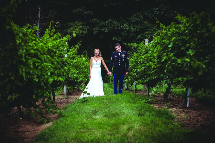 Wedding Couple walking down vineyard path